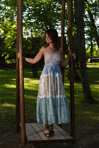 model woman dress nature trees tree swing swinging swings blue bluedress shoes necklace outdoor