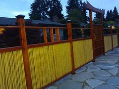 Handmade Japanese Shinto style bamboo fence and gate, flagstone walkway, Seattle, Washington, USA