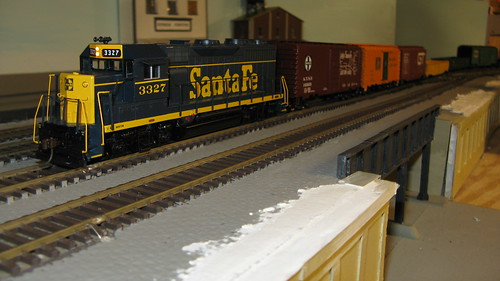 1960's era Santa Fe freight train passing over an urban viaduct. by Eddie from Chicago