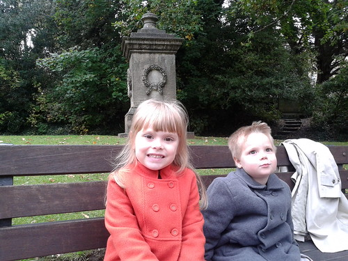 Isabella and Lucas rest in a small park in Bath