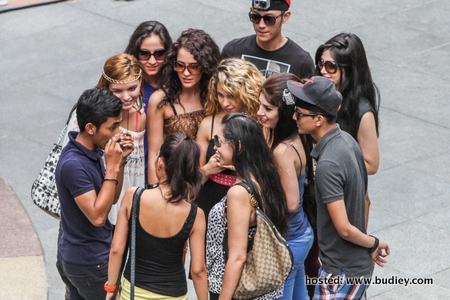 A man getting a surprise swarm of girls