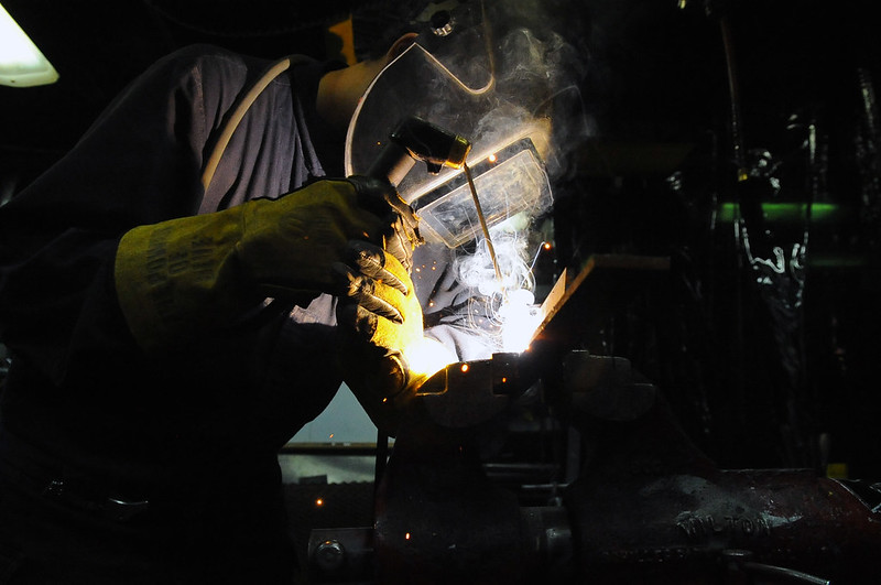 Hull Maintenance Technician 3rd Class Kyle Thiel welds a seam aboard USS Curtis Wilbur (ddg54)