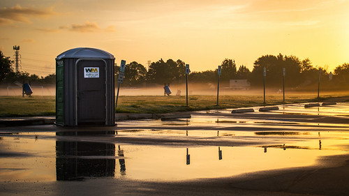sunrise morning dawn sunglow orangesky sun pinksky puddlereflection fog lowfog morningfog portapotty portopotty outhouse restroom publicrestroom beautifulsky toilet publictoilet golden magichour goldenhour