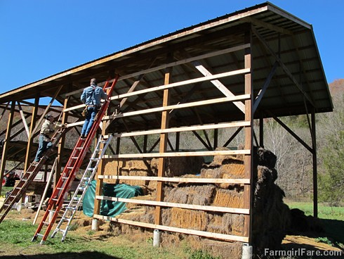 (24-6) We put our houseguests to work. Joe and his brother closing in the south side of the hay barn - FarmgirlFare.com