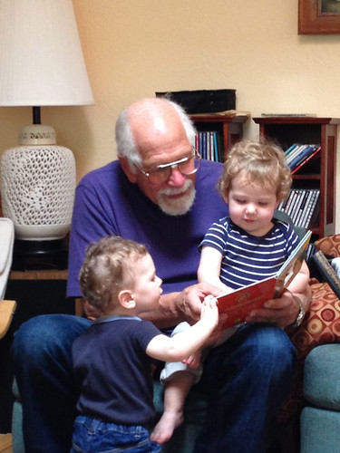 Cousins reading with Grandpa