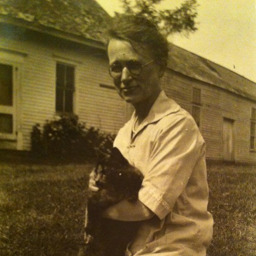 Alex's great aunt Cassie in the dooryard of the homestead #maine #vintagemaine