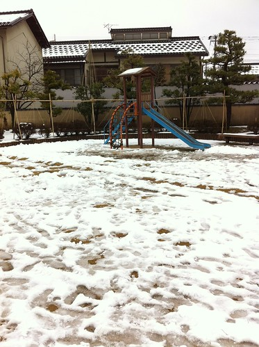 Playground covered in snow