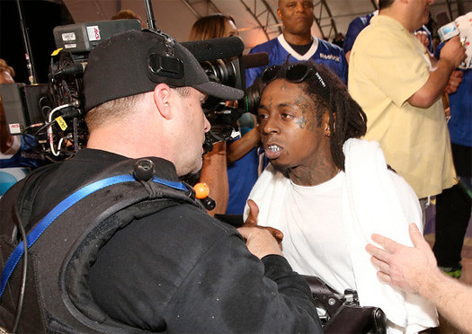 Lil Wayne Fights With Cameraman At Celebrity Beach Bowl
