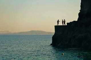 Cliff Diving in Santorini. Ammoudi Bay