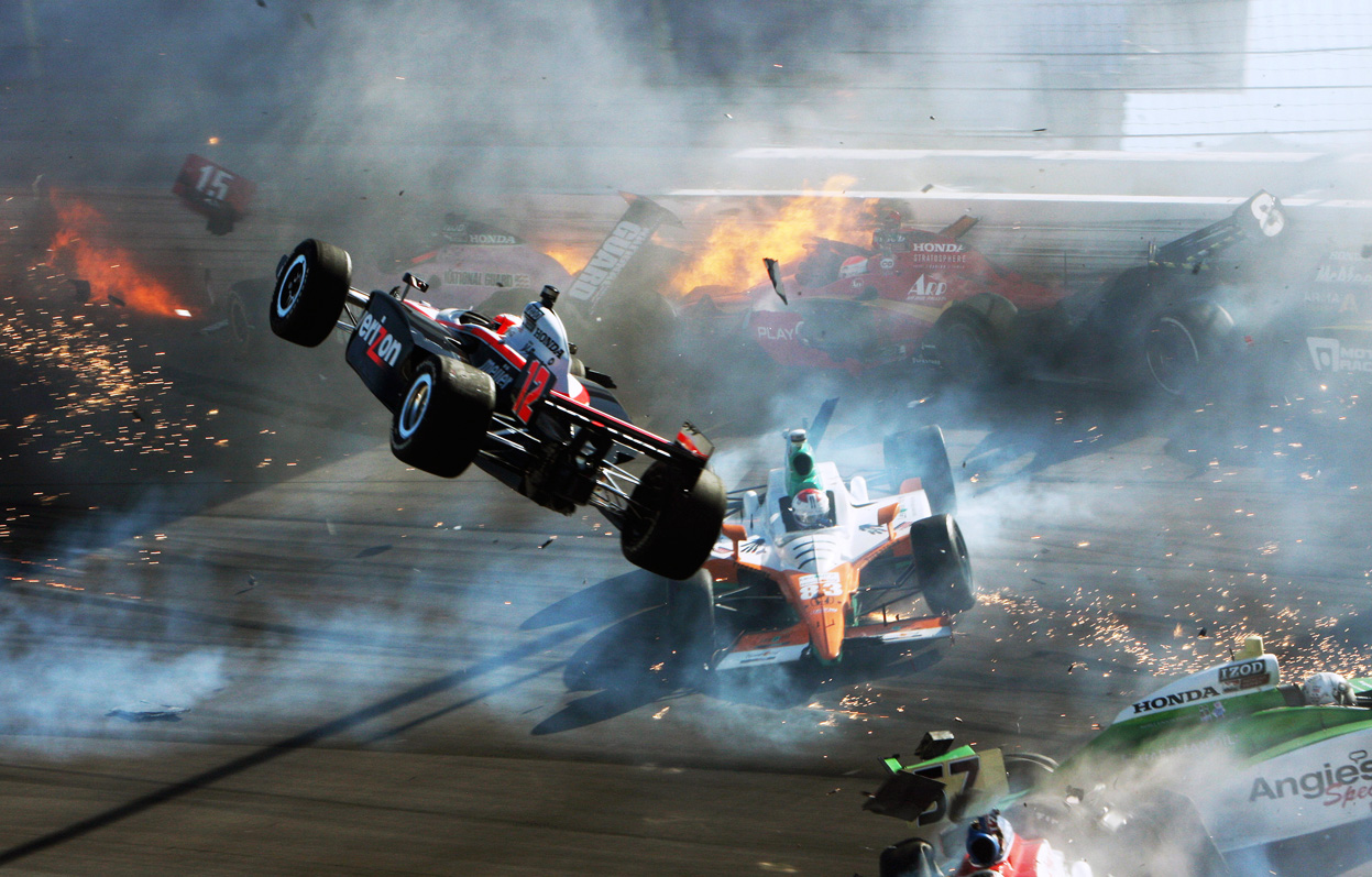 October 16, 2011 - The race car of driver Will Power (left) goes airborne during a multiple-car crash at the IZOD IndyCar World Championship race at the Las Vegas Motor Speedway. Driver Dan Wheldon was killed in the crash. Photo by Barry Ambrose
