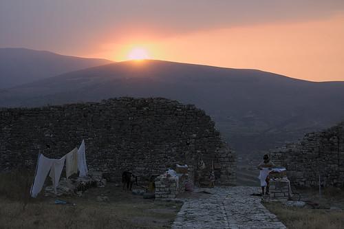 sunset sky sun mountain wall clouds albania berat