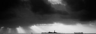 Image of  Hellestøstranden  near  Sola. ocean light sea sky lighthouse white black monochrome norway dark boat norge ship dramatic himmel sola fyr rogaland fyrtårn hellestø feistein