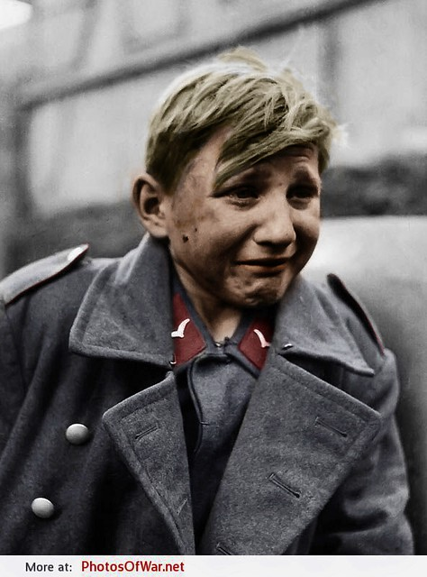 15 year old Flakhelfer Hans-Georg Henke after being taken captive by soldiers of the 9th U.S. Army in Rechtenbach, Hesse, Germany, 3rd April 1945. Photo taken by John Florea.