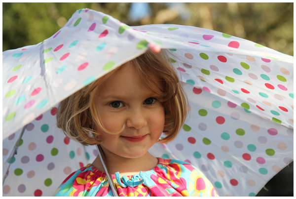 Loving her polka dot umbrella (December 2012)