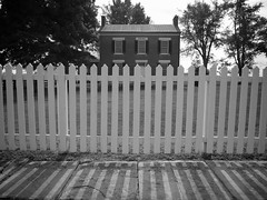 outdoor structure(0.0), baluster(0.0), gate(0.0), iron(0.0), column(0.0), home fencing(1.0), picket fence(1.0), monochrome photography(1.0), monochrome(1.0), black-and-white(1.0),