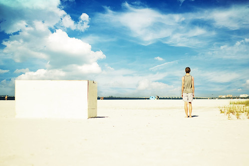 ocean bridge blue boy portrait sky sun guy green beach water grass sunshine clouds landscape model sand open tank box top sunny buidings
