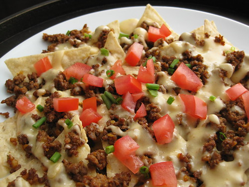 homemade nacho cheese sauce and taco seasoning-spiced beef / nachos supreme copycat