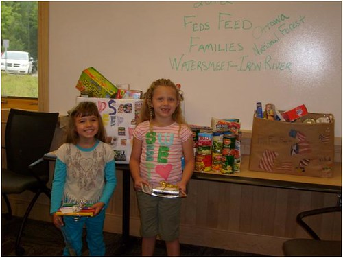 Two daughters of Ottawa National Forest employees with their decorated boxes filled with employee donations.