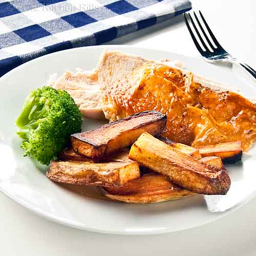 Roast Potatoes on Plate with Chicken and Broccoli
