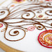 Brown, Orange, Yellow and Red Flowers and Swirls Embroidery - close-up