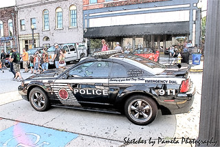 Cartersvile Police Department's D.A.R.E. cars patrol during The Summer Concert Series.