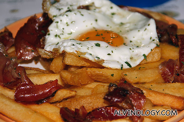 Huevos Rotos with fries and Jamon