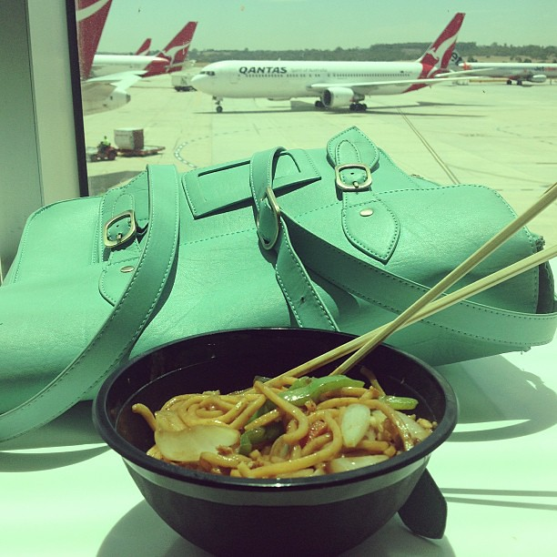 Eating overpriced mi goreng at Melbourne airport waiting for my connecting flight in two hours and quite bored - any fun ideas to pass the time?