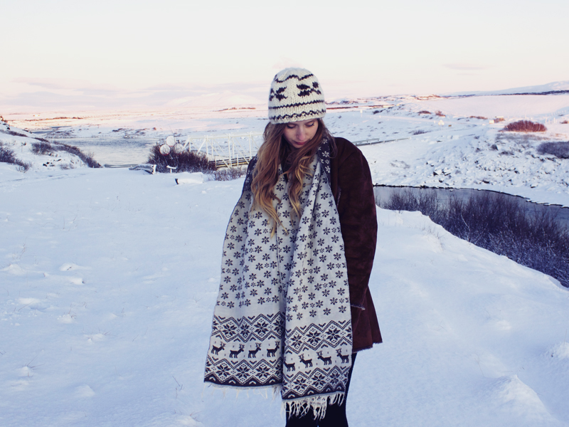 reindeer scarf, thrifted coat, woolly hat, snow in Iceland