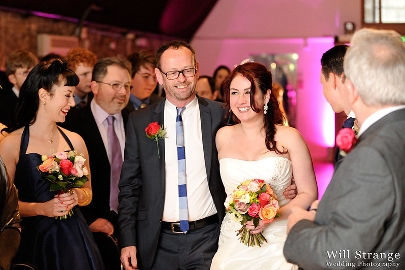 Bride and her father walking up the aisle at Vinopolis