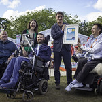 Winners of the Euan's Guide Accessible Festival Best Pop-Up Venue Award | Book Festival Director Nick Barley is presented with the award by members of the Euan's Guide team © Robin Mair