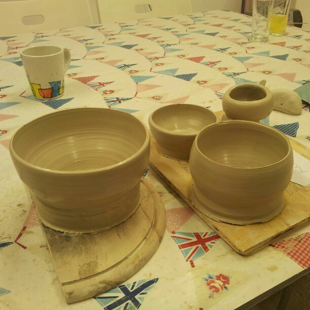 Week 6 pots. Larger ones are much harder to centre. After they're off the wheel you see how much more of the bases should have been cut away.