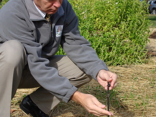 Bob Snieckus, USDA-NRCS National Landscape Architect, checks the irrigation system in the People's Garden at USDA Headquarters in Washington, DC.