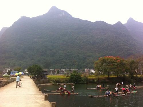 Chinese tourists on bamboo rafts were everywhere....