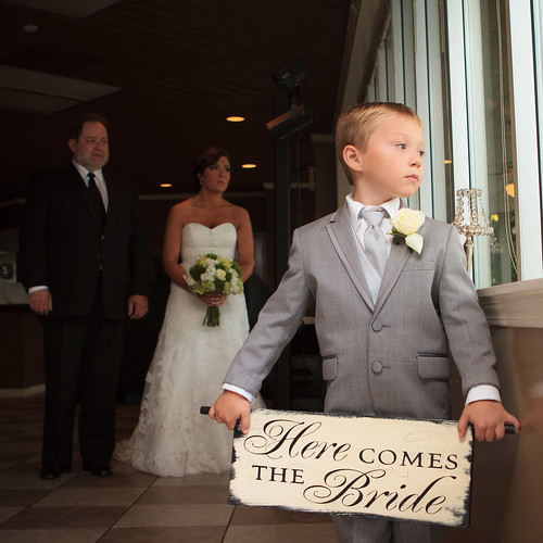Boy holding Here Comes the Bride