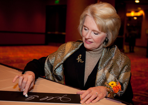 Jill Geisler, one of our honorees, signing a plaque at the Hall of Fame on Friday, Oct. 26, 2012.