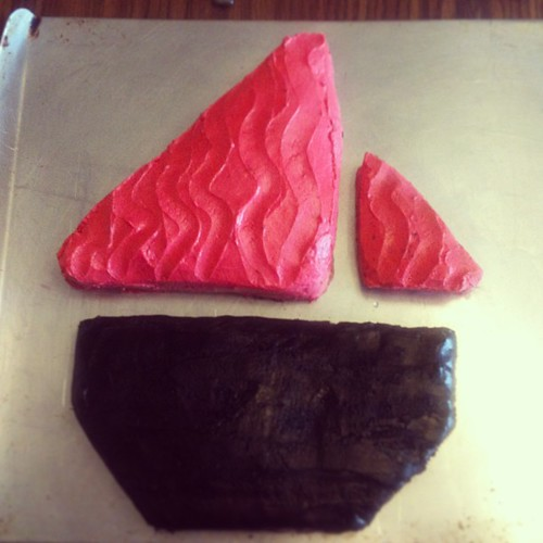 The red-sail boat cake - needs a different frosting for the bottom and some additional components to make it recognizable as such - a licorice mast and the round windows. But not this time.