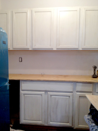 Diy installing kitchen cabinets for Attaching kitchen cabinets
