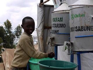 Washing hands at an Oxfam water point