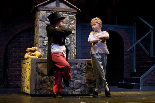 Rhona Smith as Dodger (L) and Jacob Merchant as Oliver in Balerno Theatre Company's production of Oliver!. Church Hill Theatre, Edinburgh, October 2012. Photo credit: Alkisti Terzi.
