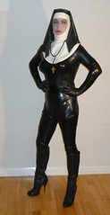 sculpture(0.0), toy(0.0), latex clothing(1.0), adult(1.0),