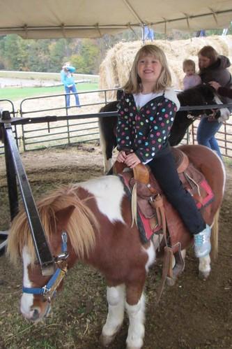Catie on the pony rides