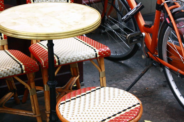 red cafe chairs an cycle paris