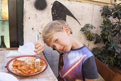 Theo eating ravioli