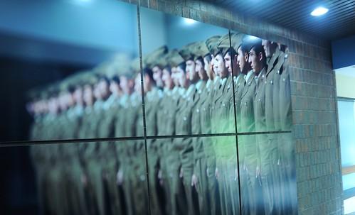 Photo wall, military officers in green uniforms, Motorola Solutions, Schaumburg, Illinois, USA by Wonderlane