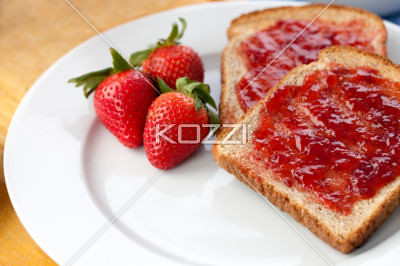 image of brown bread with strawberry jam