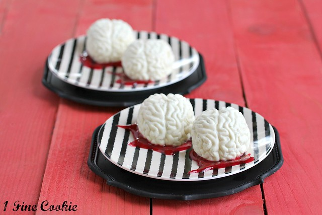 halloween snack brains made from cream and raspberry sauce
