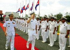 Rear Adm. Tom Carney, commander of Task Force 73, salutes Royal Cambodian Navy officers after meeting with staff officers at the Ream Navy Base Oct. 22 during exercise Cooperation Afloat Readiness and Training (CARAT) Cambodia 2012. (U.S. Navy photo by Mass Communications Specialist 1st Class Robert Clowney)