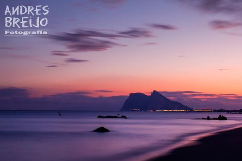 sunset sky españa beach backlight clouds contraluz lights luces mar spain playa andalucia cielo nubes cadiz gibraltar roca anochecer orilla peñon alcaidesa