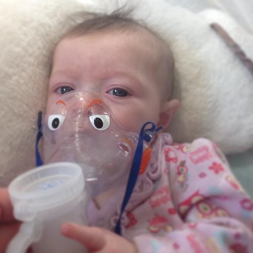 Sick baby Olive taking her meds.