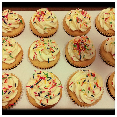 Vanilla cupcakes with frosting... Ready for tomorrow!